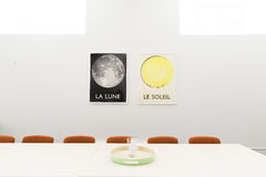 Pictures of Sun and Moon on meeting room wall