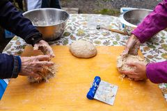 Kneading bread as part of an outdoor bread making workshop stock image
