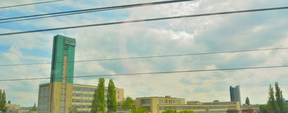 Pictures taken on a speeding train: Modern landmarks at the entrance of Brussels. And train-cables Royalty Free Stock Photo