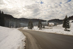 Picturesque. House surrounded by woods during winter in the mountains stock photo