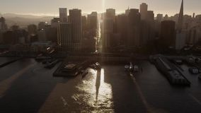 Picturesque aerial drone view on modern urban downtown skyscraper architecture skyline sunset cityscape of San Francisco. Picturesque aerial view on modern urban stock footage