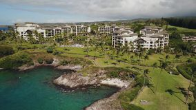 Beautiful majestic resort montage kapalua drownes in tropical luxury on a bird`s eye view on island maui,hawaii stock video
