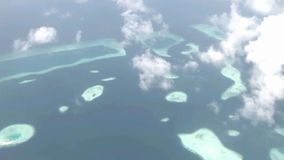 Picturesque aerial helicopter flyover white fluffy clouds in sky over wild nature turquoise lake green tropical forest. Fascinating aerial helicopter flyover stock video footage