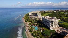 Aerial view of fashionable resort hyatt on the coastline of the pacific ocean on island maui,hawaii. Picturesque aerial panorama of modern luxurious resort hyatt stock video footage