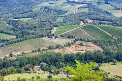 Picturesque aerial view at Tuscany landscape in summer. With small farms, hills and vineyards, rural italian countryside royalty free stock photos