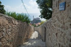 Picturesque Alley with View onto Lovrijenac Fort in Dubrovnik, C. Picturesque Alley with View onto Lovrijenac Fort in Dubrovnik in Croatia Stock Photo