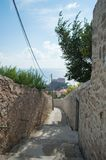 Picturesque Alley with View onto Lovrijenac Fort in Dubrovnik, C. Picturesque Alley with View onto Lovrijenac Fort in Dubrovnik in Croatia Royalty Free Stock Photos
