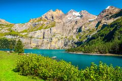 Picturesque alpine lake with high mountains and glaciers, Oeschinensee, Switzerland stock photo