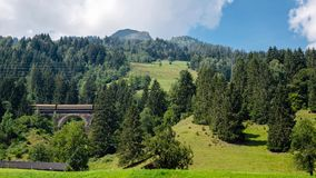 A picturesque Alpine landscape with an old railway bridge. Austria.  royalty free stock images