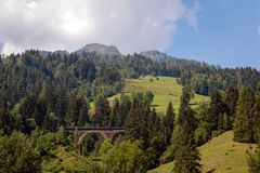 A picturesque Alpine landscape with an old railway bridge. Austria. A picturesque Alpine landscape with an old railway bridge. Austria stock image