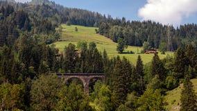 A picturesque Alpine landscape with an old railway bridge. Austria royalty free stock photos