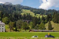 A picturesque Alpine landscape with an old railway bridge. Austria royalty free stock photo