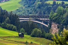 A picturesque Alpine landscape with an old railway bridge. Austria royalty free stock images