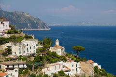 Picturesque Amalfi Coast. Stunning view over the picturesque Amalfi coast in Italy - crystal clear Meditteranean sea, rocky mountains, blue sky and a typical Royalty Free Stock Image