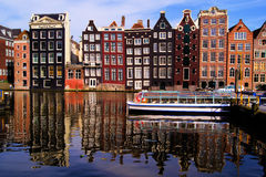 Picturesque Amsterdam. Traditional houses of Amsterdam with reflections in the canal, Netherlands Stock Photo