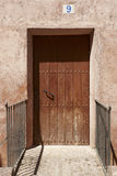 Picturesque and ancient wooden door entance. Spain Royalty Free Stock Images