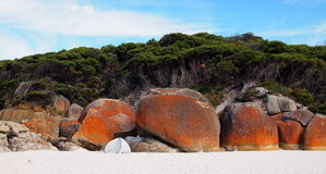 Picturesque australian beach. Beautiful beach with picturesque stones and white sand Royalty Free Stock Photo