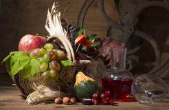 Picturesque autumn composition with basket, fruits, pumpkin, mug royalty free stock photo