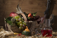 Picturesque autumn composition with basket, fruits, pumpkin, win Stock Photo