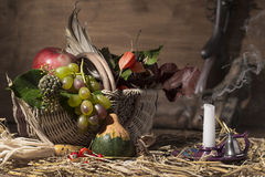 Picturesque autumn composition with basket, fruits, pumpkin, win Stock Image