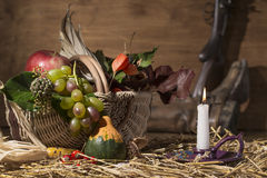 Picturesque autumn composition with basket, fruits, pumpkin, win Stock Images