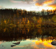 Picturesque autumn landscape. Lake in sunset rays. Fall landscape Royalty Free Stock Photos
