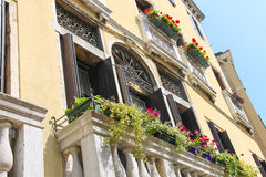 Picturesque balcony with flowers Stock Images