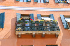 Picturesque balcony with flowers in an old  house Royalty Free Stock Image