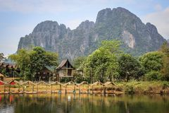 The picturesque banks of the Mekong River in the village of Vang Vieng stock photo