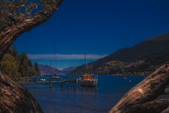 Picturesque bay with moored boats on pier royalty free stock photography