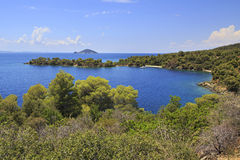 Picturesque bay and turtle island in Aegean Sea. Royalty Free Stock Photography