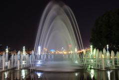 Picturesque, beautiful big fountain at night, city Dnepr. Evening view of Dnepropetrovsk, Ukraine. Picturesque, beautiful big colored fountain at night, city royalty free stock images