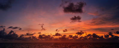 Picturesque beautiful view of sky at sunset over tropical ocean. Picturesque beautiful panoramic view of the sky at sunset over tropical ocean royalty free stock images