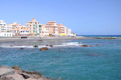 Picturesque black pebble beach in Las Galletas on the south of Tenerife Royalty Free Stock Images