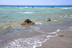 Picturesque black pebble beach in Las Galletas on the south of Tenerife. Spain Royalty Free Stock Photography