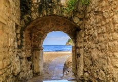 Free Picturesque Brick Arch And Path Of The Medieval Old Town Open Onto The Adriatic Sea In The Balkans In Budva, Montenegro Stock Images - 153524474
