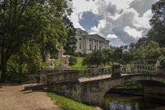 Picturesque bridge with centaurs and Palace, Pavlovsk park, subu Stock Photography