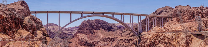 Picturesque bridge over the Colorado River. Nevada, United States. Tourist attraction of Nevada and Arizona, USA. The Hoover Dam and the arch bridge over the Stock Photos