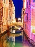 Picturesque canal with bright colorful buildings and little bridge. At night with beautiful reflection in water. Venice. Italia royalty free stock photo
