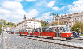 Picturesque capital of the Czech Republic. Red trams on the ancient streets of Prague Stock Photos