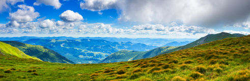 Picturesque Carpathian mountains landscape in summer, wide angle panoramic view, Ukraine. Royalty Free Stock Image