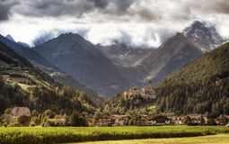 Picturesque castle and mountains. Picturesque old castle and mountains in Background (Castle Taufers South Tirol Royalty Free Stock Photos