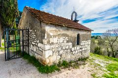 Picturesque chapel in Salona province, Croatia. Scenic view at picturesque chapel in Salona, roman province from ancient time in Croatia, Europe Royalty Free Stock Images