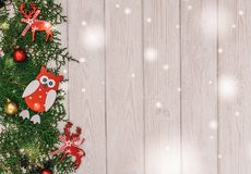 Winter festive decorations. Christmas card with fir-tree toys Stock Photo