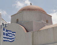 Picturesque church and Greek flag Stock Photo