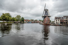 Picturesque cityscape with beautiful traditional house, windmill Royalty Free Stock Image