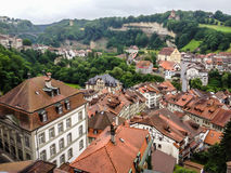 Picturesque cityscape of medieval town Fribourg with its gothic cathedral, old town and ancient fortification, Switzerland, Europe Stock Photos