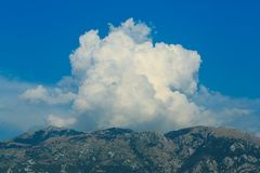 Picturesque clouds over the mountains, Montenegro Stock Photos