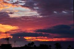 Picturesque cloudy sky over Mediterranean sea. Mulkticolored sky orange bue grey colors. Sunrise in south of Spain stock photos