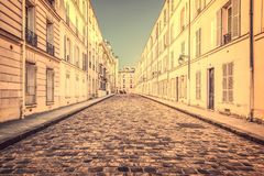 Picturesque cobbled street in Paris France. Picturesque cobbled street in Paris, France Royalty Free Stock Photos